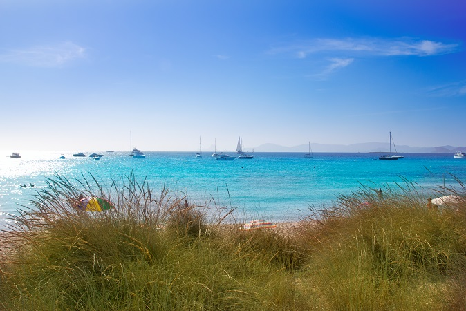 Illetes Formentera beach turquoise water with Ibiza mountains away