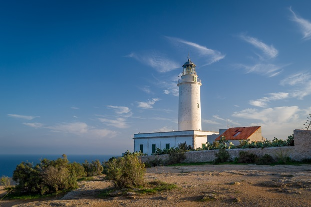 Big lighthouse an the south of Formentera island just before sunset.
